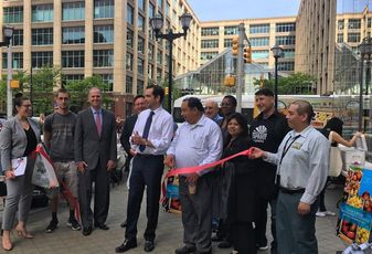 Officials and vendors celebrate the opening of the Exchange Place Special Improvement District farmers market in front of Mack-Cali's 5 Harborside in Jersey City.