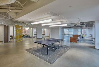 Brookfield's spec suite for HyreCar includes a lot of open space, a ping-pong table and kitchen.