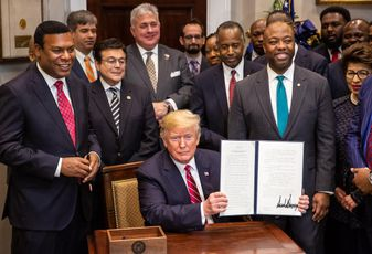 President Donald Trump displays his signature Dec. 12, 2018, after signing the Executive Order to establish the White House Opportunity and Revitalization Council in the Roosevelt Room of the White House.
