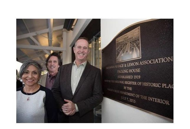 (L-R) Anaheim Community Investment Manager Laura Alcala, Community and Economic Development Director John Woodhead, and Mayor Tom Tait pose with The Packing House Placard.