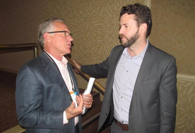 Space Between Design Studio's Patrick Kennedy (right) talking with James Hankins at Bisnow DFW mixed-use event May '16