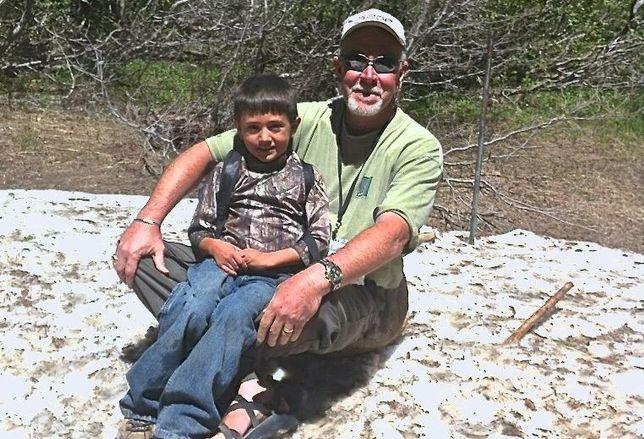 Brad McJunkin, Director of Acquisitions and Development at TIG, with grandson Isaiah hiking in Estes Park