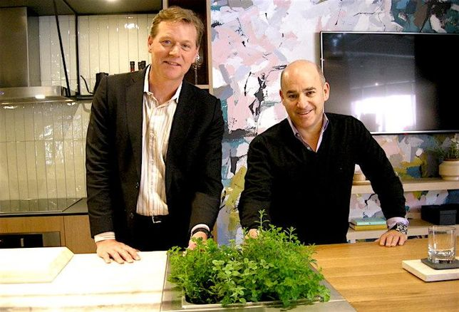 Windmill Developments CEO Jonathan Westeinde and Curated Properties partner Adam Ochshorn are pictured with a micro-garden, included in kitchens at The Plant.
