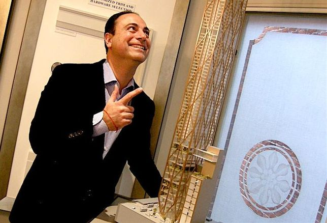 Mizrahi Developments president Sam Mizrahi, with a model of The One, an 80-storey mixed-use tower planned for 1 Bloor St. W.