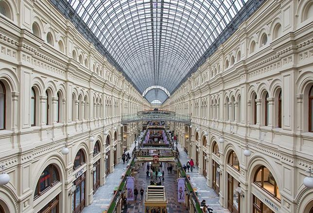 A seemingly endless corridor of the shopping center ГУМ in Moscow, Russia.