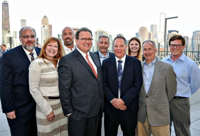 Executives from Ascend Real Estate Group celebrate the grand opening of Niche 905, an 18-story, 202-unit luxury apartment tower on Chicago's Near North Side.