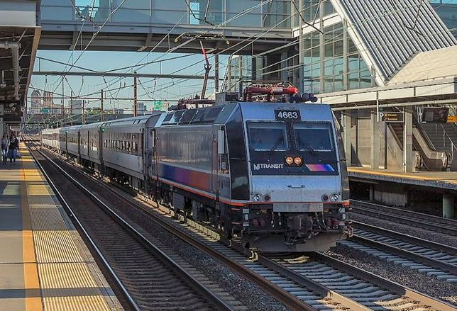 A New Jersey Transit train travels through the Newark Liberty International Airport train station in Newark, New Jersey