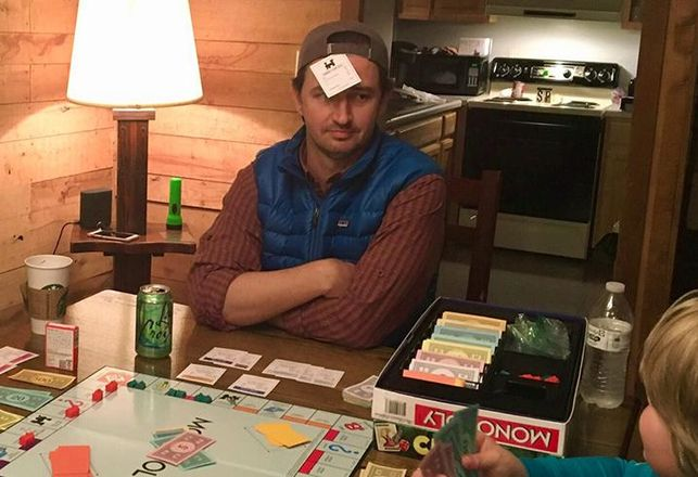 "Aaron Ligon, Managing Principal, Broker-in-Charge, The Sterling Group. Photographic evidence of Aaron Ligon's most recent Monopoly win. ""Here, I am hard-trading my son Philip with a railroad and cash for Boardwalk,"" he said. ""No shelter here, son."""