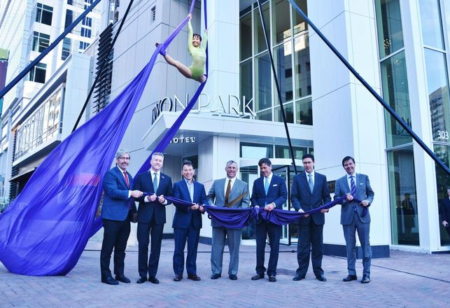 300 South Tryon celebrated its grand opening with business and city leaders and an aerialist.