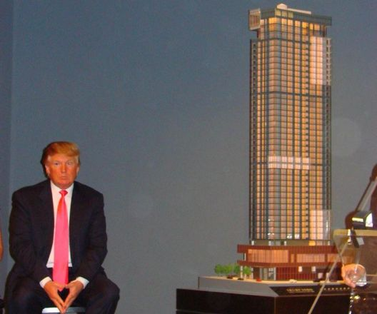 Donald Trump in 2007 with a scale model of the Trump SoHo Hotel