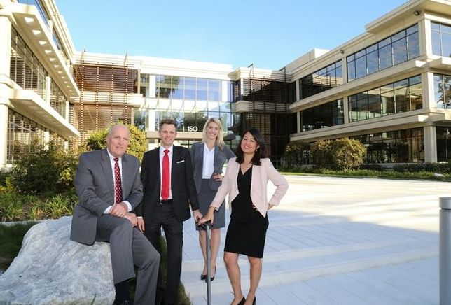 Charles Dunn team at 150 North Orange Grove Blvd. property which sold to Doheny Eye Institute - from left to right: Bill Boyd, Scott Unger, Lauren Nesmith, and Linda Lee.