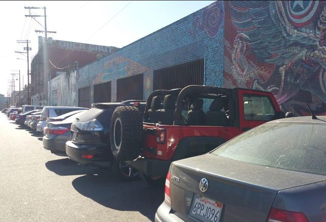 Rows of parked cars fill the Los Angeles Arts District.