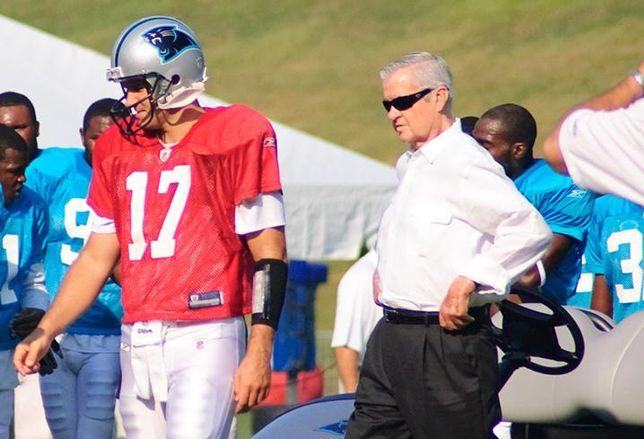 Jerry Richardson, right, walks with Jake Delhomme during Carolina Panther's Training Camp at Wofford College in Spartanburg, S.C., in 2009.