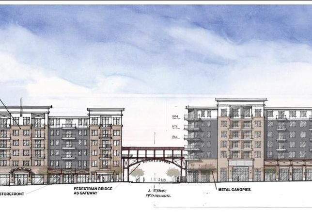 A proposal from Corporate Realty, Inc. would bring to downtown Kannapolis apartments, retail, restaurants, offices and a pedestrian bridge.