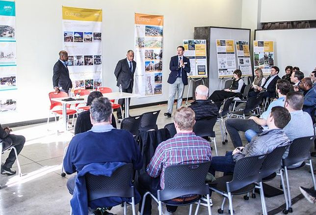 Charlotte City Planning Director Taiwo Jaiyeoba, visiting planning expert Mitchell Silver and Crescent Communities President of Commercial and Mixed Use Brian Leary speak to community members at a Unified Development Ordinance meeting.
