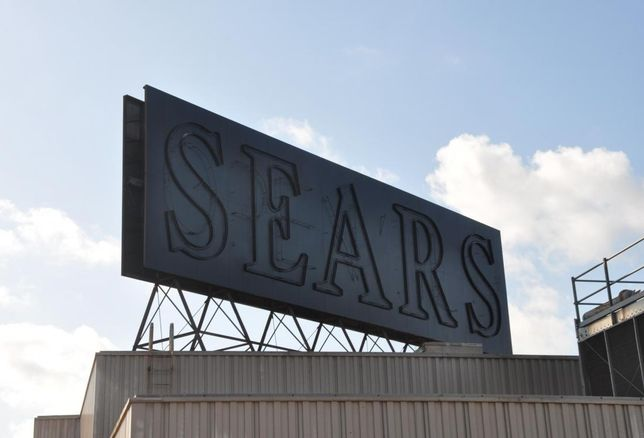 Sears' blacked out sign over its former Midtown location