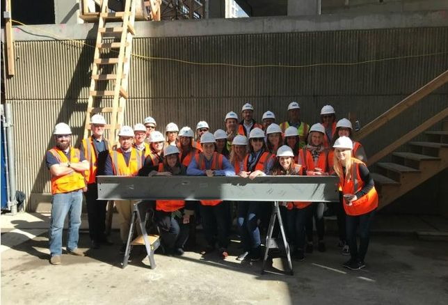 Belgravia Group recently celebrated the topping-off of its 18-story Renelle on the River luxury condominium building with a beam-signing ceremony on site at 403 North Wabash in River North.