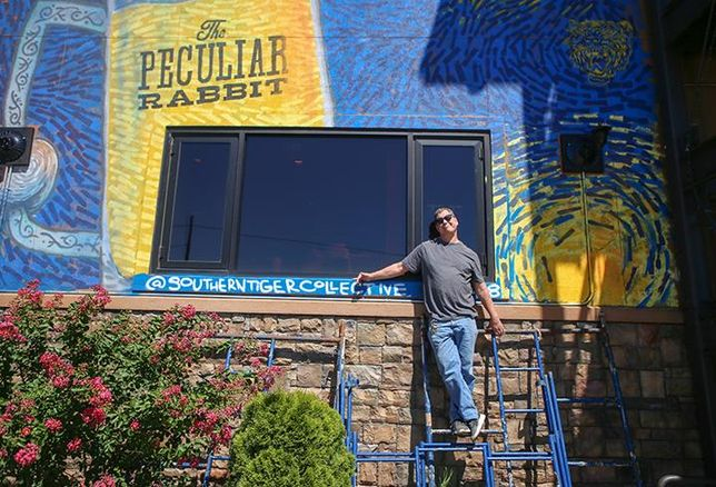 The Peculiar Rabbit owner Rob Nixon has a mural on the side of his restaurant created by Southern Tiger Collective. It serves as a way to work around the City of Charlotte's sign ordinance.
