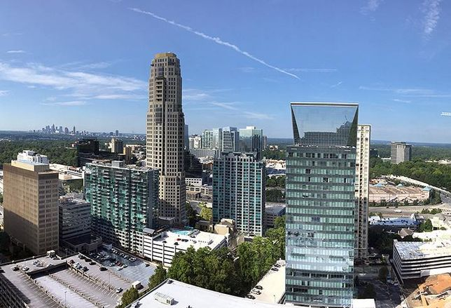 The view from the NKF Atlanta office, with the Buckhead skyline in the foreground and the downtown skyline in the background