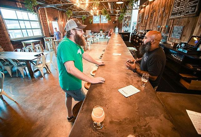 Divine Barrel Brewing owner Ben Dolphens and bartender Andrew Woods