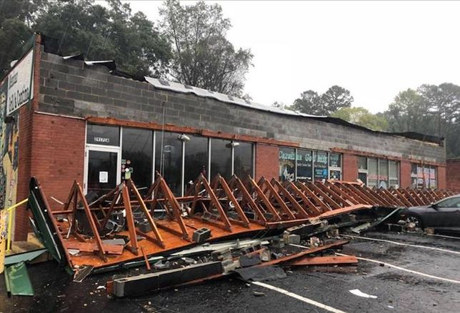 Three Amigos restaurant in Charlotte had a parapet wall and awning blown away during the storm, removing the top bond beam completely.