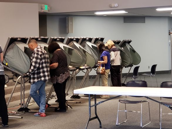 People voting at a voting booth in Orange County, California