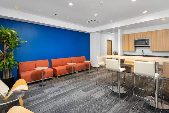 A lounge for business suite users at Optima's Signature Tower