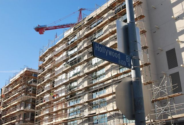 Construction crane rises over new development in Hollywood, Calif.