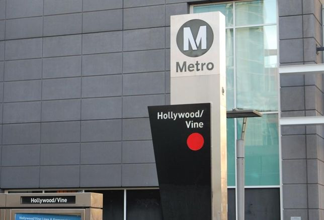 The Metro sign at Hollywood Boulevard and Vine Street in Los Angeles. Transit Oriented Communities Affordable Housing Incentive Program