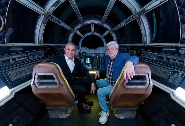The Walt Disney Co. Chairman and CEO Bob Iger and Star Wars creator George Lucas pose inside Millennium Falcon: Smugglers Run at Star Wars: Galaxy's Edge at Disneyland Park in Anaheim, California.