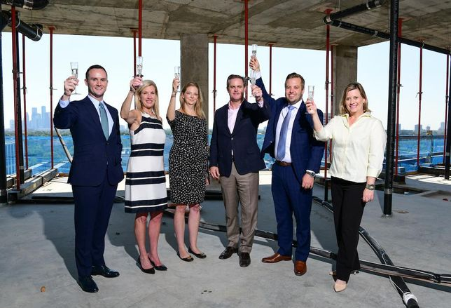 Sudhoff Cos. Jared Bonasera, Sudhoff Cos. Betty Harbourt, Pelican Builders Kerry Bollmann, Pelican Builders Derek Darnell, Sudhoff Cos. Kyle Mikulenka and Sudhoff Cos. Dina Gustin celebrate the topping off of The Revere at River Oaks, Houston.