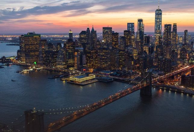 Aerial image of the Seaport District in Lower Manhattan, with the Brooklyn Bridge in the foreground