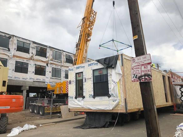 Modular Workforce Housing Project Rises Across From Mile High Stadium