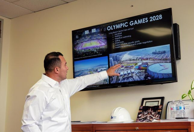 Long Beach Deputy Director of Economic Development Sergio Ramirez points at the city's preparation for the 2028 Summer Olympics in Los Angeles. Long Beach is hosting several sporting events for the olympics.