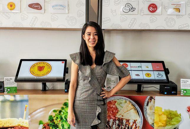 Kitchen United Director Dana Hathaitham poses inside Kitchen United's store in Pasadena