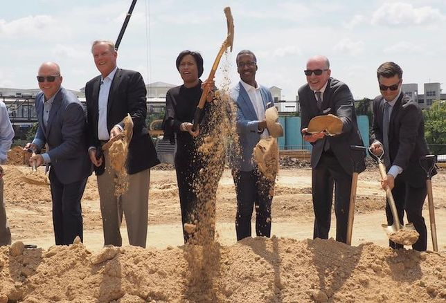 The development team and local officials celebrating the groundbreaking of MRP's Bryant Street project