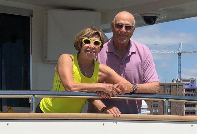 Fred Ezra and his wife, Starr, on his yacht