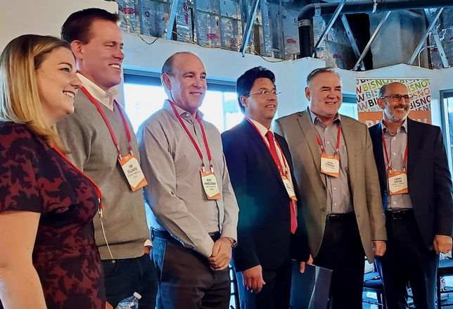 Truss' Vanessa Anderson, Paragon Commercial Group's Jim Dillavou, Lincoln Property Co.'s Kent Handleman, Colliers International's Reza Ghobadi, Parker Brown's John Parker and Unibail-Rodamco-Westfield's Larry Green pose for a picture at Bisnow's State of the Valley and Tri-Cities event at New York Life's 2300 West Empire Avenue building in Burbank.