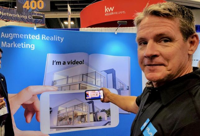 Ormond Beach, Fl.-based Realtor and CEO of AR Promotions Neal Krajewski shows off his augmented reality marketing product called Captum at the National Association of Realtors conference in San Francisco
