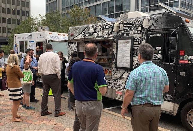 Customers at Food Truck Thursdays, a partnership between Curbside Kitchen, the Crystal City BID and JBG Smith