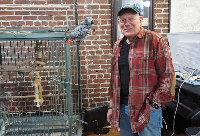 Douglas Jemal with his parrot in Douglas Development's Chinatown office