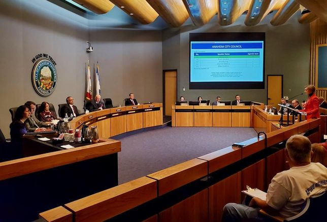 Los Angeles Angels Senior Vice President Molly Jolly (right) addresses the Anaheim City Council during a council meeting Dec. 20 at the Anaheim City Hall in Anaheim.