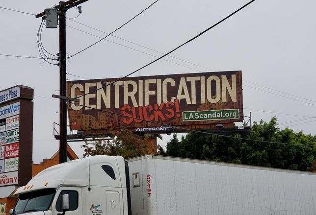 A billboard by Housing is a Human RIght, an organization that is pushing for stricter rent control in California