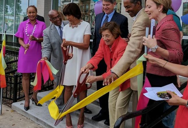 Telesis Corp. President Marilyn Melkonian cutting the ribbon on a project in Baltimore.