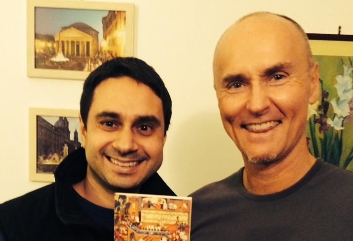Airbnb's Chip Conley with his host in Rome, Paolo, and the Rumi book