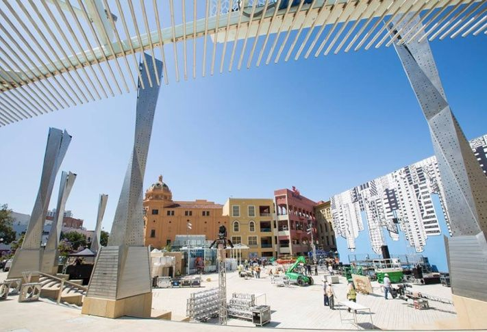 Workers preparing for the Horton Plaza Park reopening celebration.
