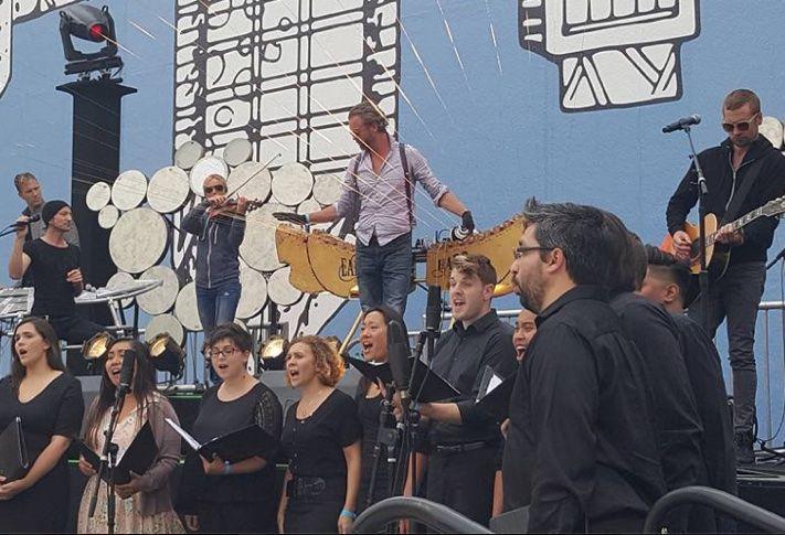 Earth Harp Collective and Sacra Profana Choir performing at Horton Plaza Park reopening celebration.