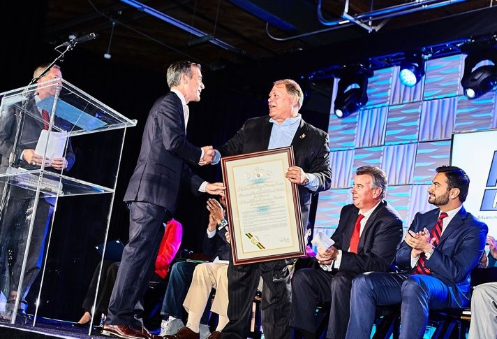 Los Angeles Mayor Eric Garcetti presents LA Chapter of the National Electrical Contractors Association chairman Jim Wilson with Dedication Plaque.