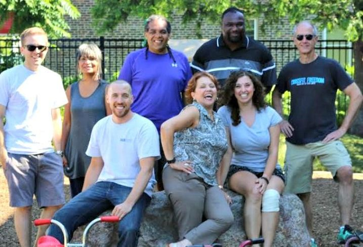 Volunteers from HSA Commercial Real Estate, led by CEO Bob Smietana (right) and SVP Josephine Thomas-Hoytt (second from left) returned to Chicago Commons' Paulo Freire Family Center in Chicago's Back of the Yards neighborhood to help freshen up the playground for the upcoming school year.