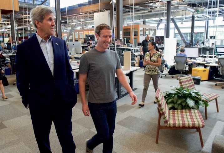 CEO Mark Zuckerberg, right, showing off the new Menlo Park HQ to US Secretary of State John Kerry in June.